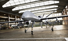 Military Drone UAV Aircraft's With Ordinance In Position In A Hangar Awaiting A Strike Mission. 3d Rendering