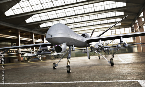 Military Drone UAV aircraft's with ordinance in position in a hangar awaiting a strike mission Fototapet
