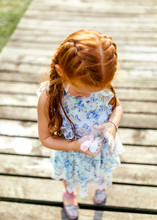 Portrait Of A Little Redhead Girl With Colored Chalks