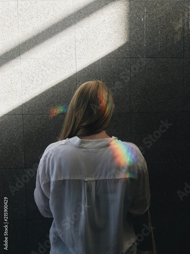 Rainbow on woman's hair and shoulder