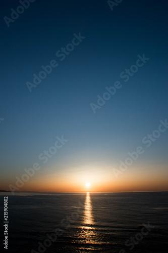Foto op Plexiglas Nachtblauw オホーツク海に沈む夕陽