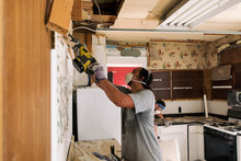 Kitchen: Man Uses Reciprocating Saw To Cut Wood