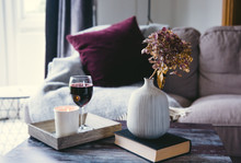 Dried Hydrangea Flowers, A Candle And Red Wine On A Wooden Table.