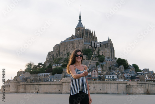 Woman taking selfie on historical site