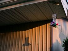 A Hummingbird Feeder And Shadow.