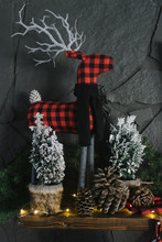 Festive Miniature Trees Decorate Mantel During Christmas  Holiday