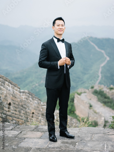 Stylish groom in suit
