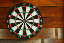 Darts Board On Wooden Wall