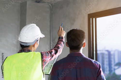 Fotografie, Tablou Client and Contractor discussing plan to renovation house.