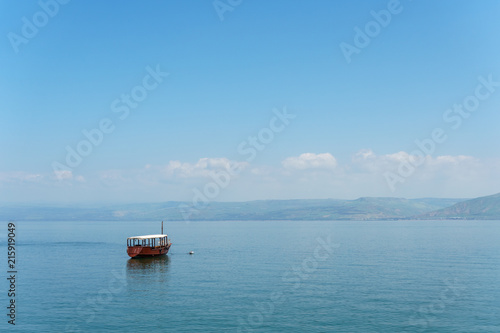 Canvas-taulu Old boat on Sea of Galilee in Israel at foggy spring day.