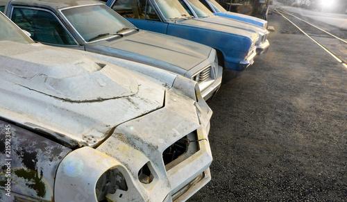 Photo old rusty cars in auto salvage junkyard