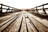 Fototapeta Perspektywa 3d - Wooden bridge stretching into the sea.