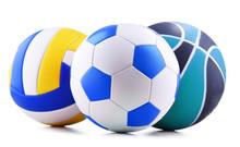 Three Sport Balls Over White B...