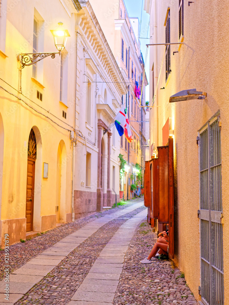 Beautiful narrow alley in the old town of Alghero. Sardinia, Italy.