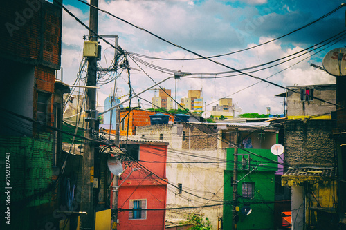 Fotografija  Colourful worn houses of a favela in Brazil.