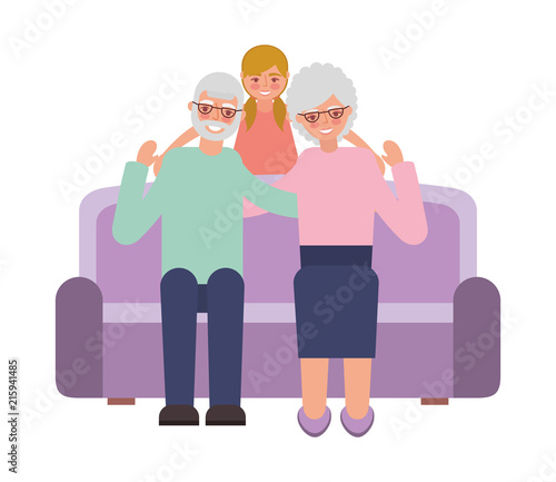 Fototapety, obrazy: grandparents with granddaughter sitting on sofa