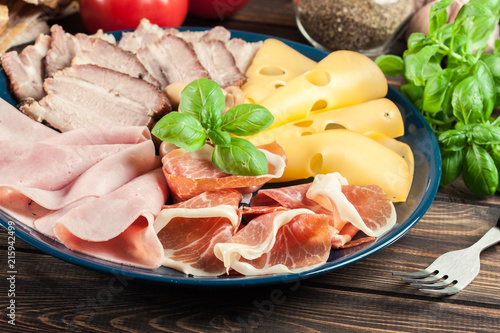 Foto op Aluminium Assortiment Cold meat platter with ham, prosciutto, bacon and cheese