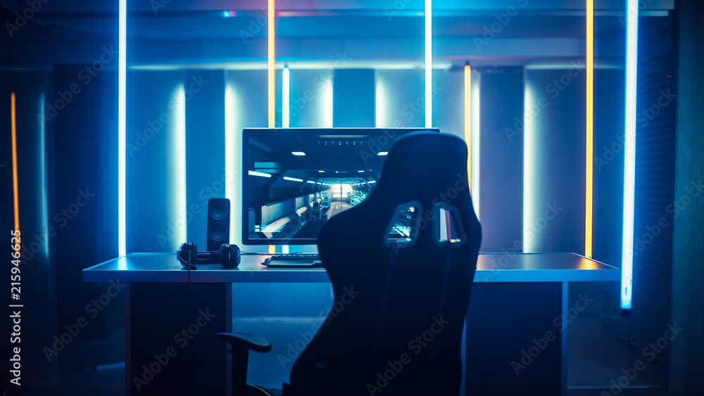 Fototapeta Professional Gamers Room With Ultra Powerful Personal Computer. Paused First-Person Shooter Game on Screen. Room Lit by Neon Lights in Retro Arcade Style. Cyber Sport Championship.