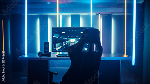 Fototapeta Professional Gamers Room With Ultra Powerful Personal Computer. Paused First-Person Shooter Game on Screen. Room Lit by Neon Lights in Retro Arcade Style. Cyber Sport Championship. obraz