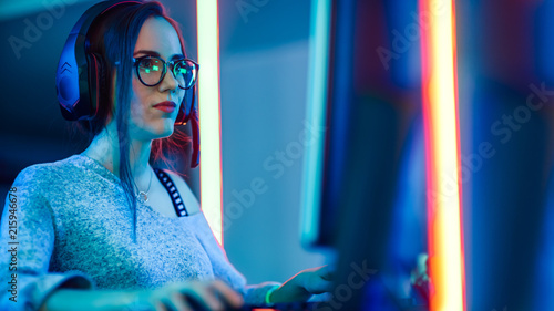 Portrait Shot of a Beautiful Professional Gamer Girl Playing in First-Person Shooter Online Video Game on Her Personal Computer Wallpaper Mural