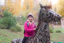 A Girl In An Autumn Park On An...