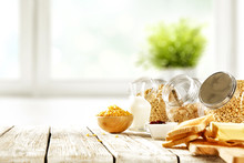 Continental Breakfast And Blurred Background Of White Window With Green Plant. Free Space For Your Decoration.