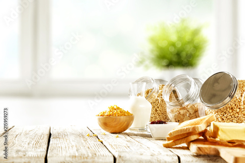 Cuadros en Lienzo Continental breakfast and blurred background of white window with green plant