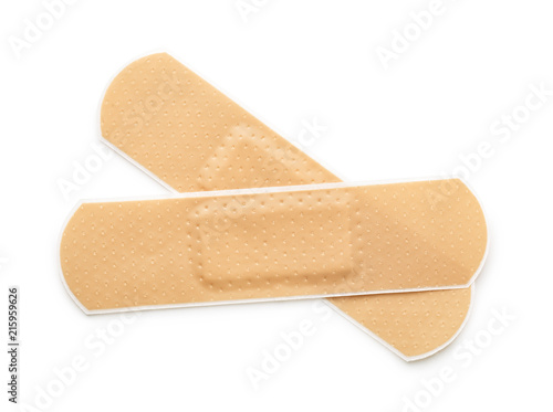 Obraz na plátně Top view of two beige adhesive bandages