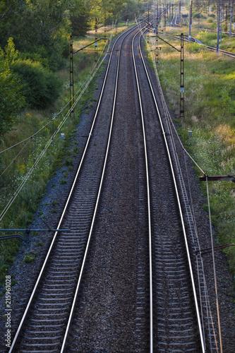 Railway rails leaving for the horizon
