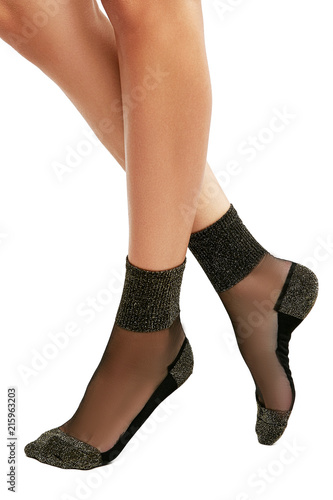 f290ddfe7 Cropped side view of woman s legs in sheer ankle high socks with sparkly  metallic cuffs