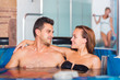 Couple is resting in pool in time spa-day