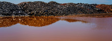 Waste Of Mining Industry Rainwater Colored With Ferrous Salts, Pollution Of The Environment.