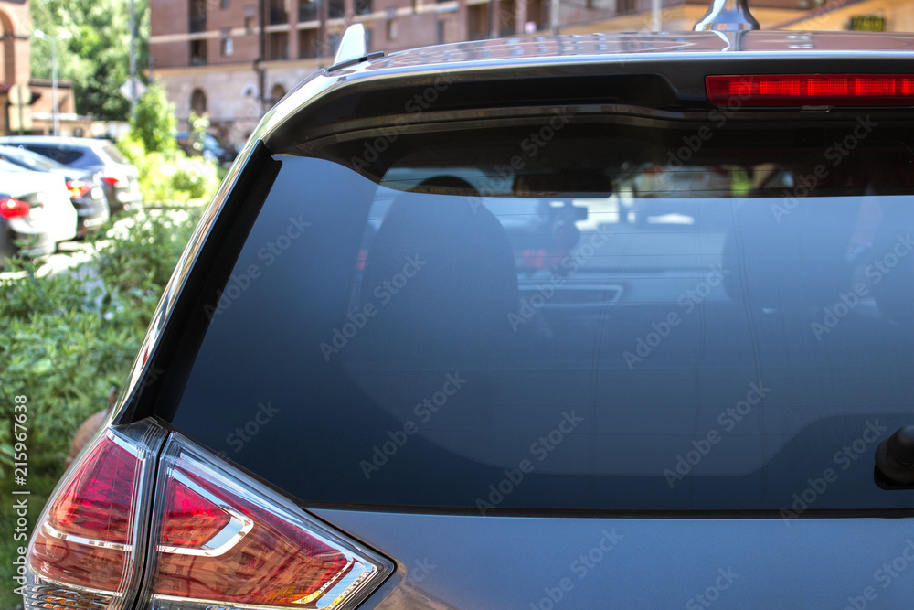 Fototapety, obrazy: Back window of a car parked on the street in summer sunny day, rear view. Mock-up for sticker or decals