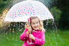 Little Girl With Umbrella In T...