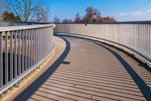 Pedestrian Overpass With Metal Raillings On Sunny Day.