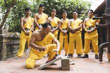 Vietnam, Hanoi, Men Exercising Kung Fu, Man On Flagstone