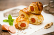 canvas print picture - Small sausage rolls baked in pastry