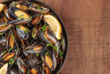 Skillet Of Marinara Mussels On Rustic Background With Copy Space