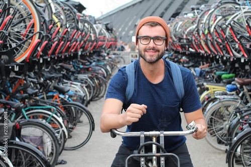 Fotobehang Fiets Man smiling at bicycle parking lot