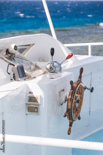 Printed kitchen splashbacks Fishing Wooden Navigation Bar on White Diving Boat with Red Sea in the Background.