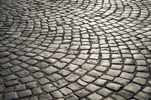 Full Frame Background Of Old-fashioned European Cobbled Plaza Laid Out In Circular Pattern In Naples, Italy