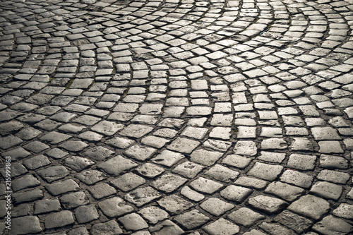 Fotografia, Obraz Full frame background of old-fashioned European cobbled plaza laid out in circul