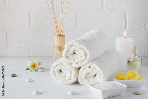Foto op Canvas Spa Spa still life with towel,white lily, sea salt, bath oil, sugar body scrub and candle