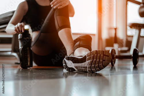 Fototapeten Tanzschule Relaxing after training.beautiful young woman looking away while sitting at gym.young female at gym taking a break from workout.
