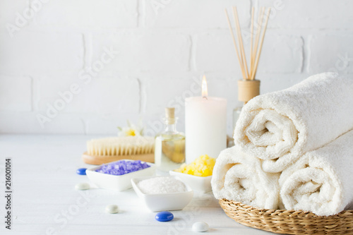 Poster Spa Body care set for peeling. With towel,white lily, sea salt, bath oil, sugar body scrub, massage brush and candle