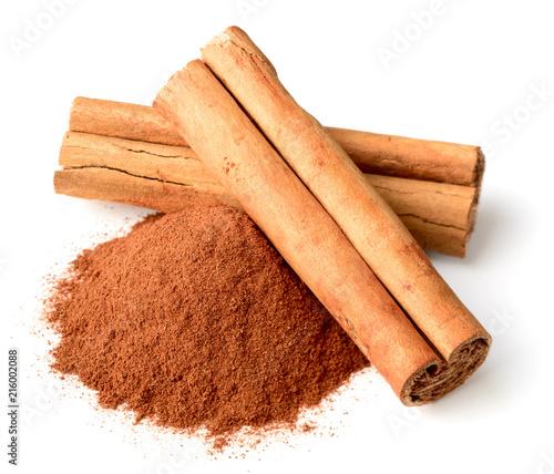 Fotografie, Obraz cinnamon powder and sticks isolated on white