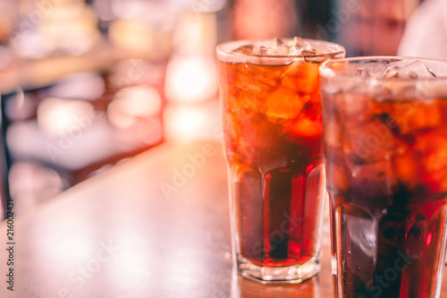 Poster de jardin Bar Two glass soft drink with ice in restaurant background