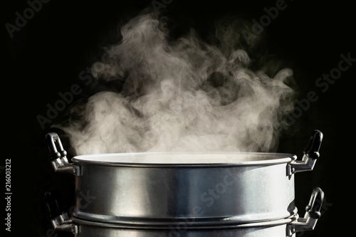 Tablou Canvas Traditional steamer pot with white smoke while cooking