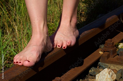 dc643d8d18f Women S Bare Feet With Red Nails On Rails Woman Without Shoes