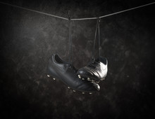 Soccer Shoes Hanging On Rope A...